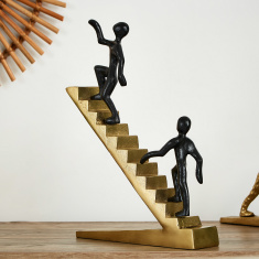 Quartz Metal Figures Climbing Up Stairs Accent